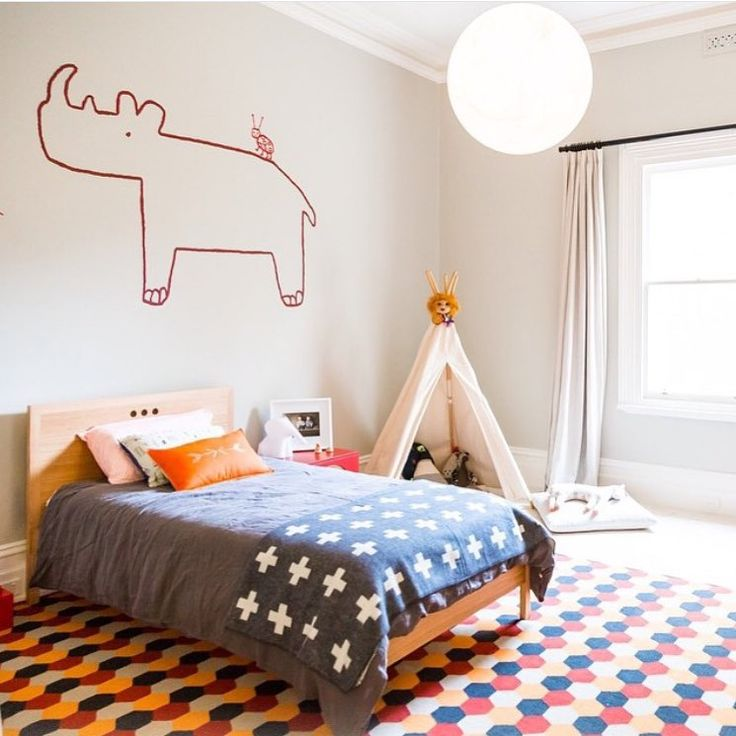One very fabulous red rhinoceros and our Hexagon rug. Regram via @hidesleep…