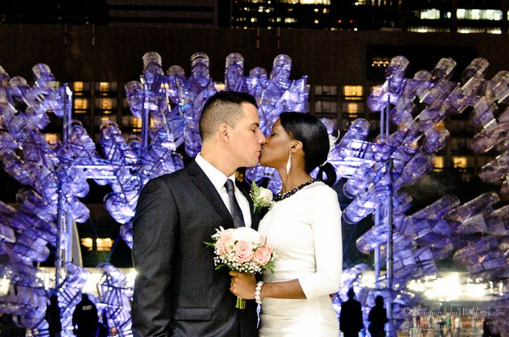 """Wedding shot at Toronto City Hall with the artistic creation of Ai Weiwei """"bikes"""" in the background, part of Nuit Blanche 2013 in Toronto, Canada."""