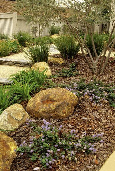 Contemporary Garden Details: Brown Contemporary Garden Keywords: Dry Garden, Stone, Garden, Mulch, Ceanothus, Ceanothus Yankee Point, Landscaping, Flowers, Yard Stones (Source: Red Cover)