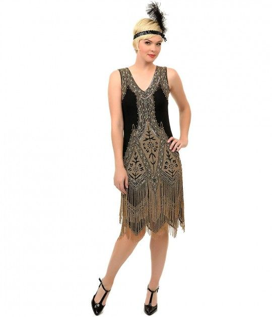 Looking for the ultimate glitzy dress? Youll look like royalty in this Black & Gold Embroidered Somerset Flapper Dress from Unique Vintage. Inspired by the Great Gatsby himself, this 1920s-style frock is worthy of any ritzy party or dance. Its completel