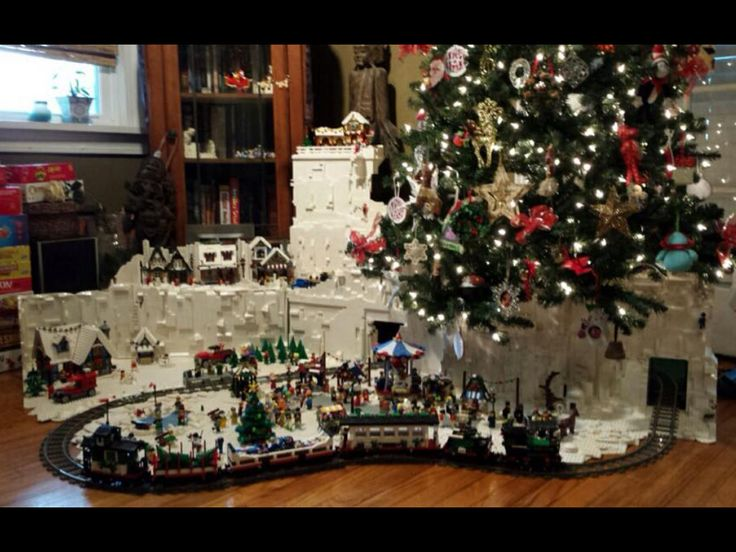 """Awesome LEGO Christmas Tree Village.  A different approach to the classic """"train around the tree"""".  Includes a winter carnival, cottage, tree farm, village, North Pole and Santa in flight."""