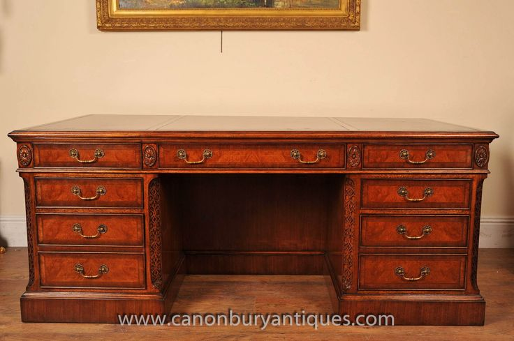 http://canonburyantiques.com/s/desks/victorian-desks/1/  Victorian partners desk in walnut. Sumptous patina to the walnut on this gorgeous Victorian desk, great for a home office set up..