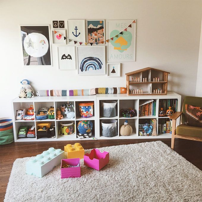 play area with two 2x4 IKEA kallax shelves, soft rug + reading chair