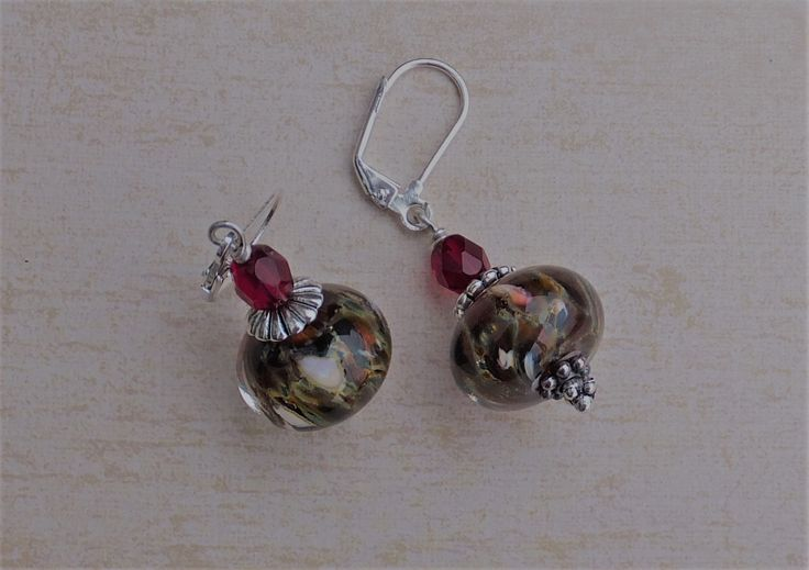A pair of earrings made for the BSBP Bead Hoarders Edition. The lampwork beads by LizBeads and garnet Czech fire polished beads were sent to me by my awesome partner Hajer Waheed Khalil. I added some sterling silver spacers.