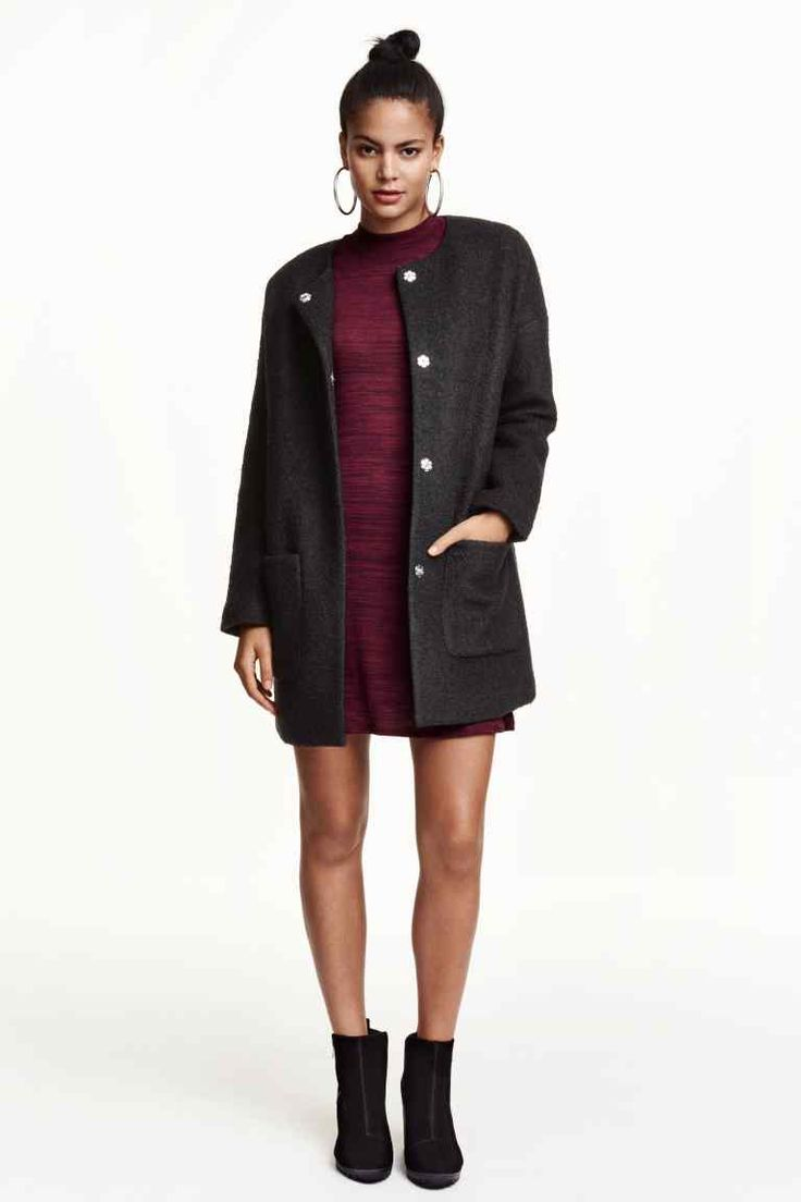 Straight-cut coat in wool-blend bouclé fabric. Round neckline, dropped  shoulders, long sleeves, concealed snap fasteners at front, and patch  pockets. Lined.