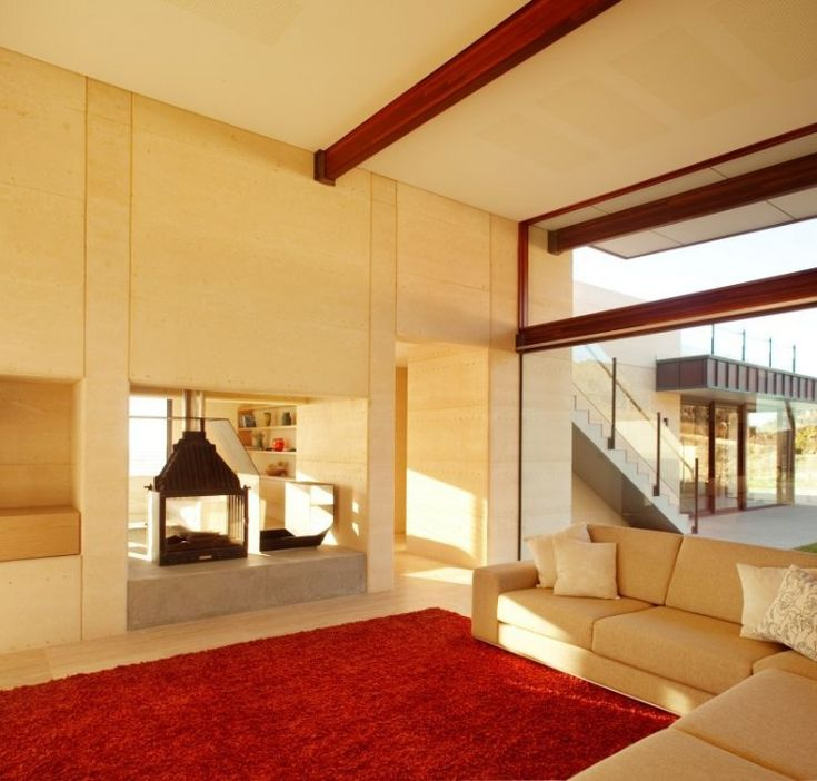 Stunning View From A Modern Minimalist House:living-room-with-sofa-cushion-ren-furry-rug-cream-color-of-wall