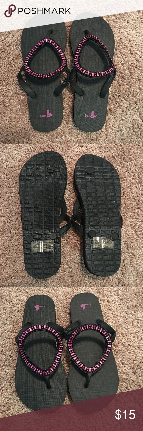 Black sanuk flip flops Brand new, never worn. Still has stickers! There is one gem on the left sandal that is dis colored, not missing! Sanuk Shoes Sandals