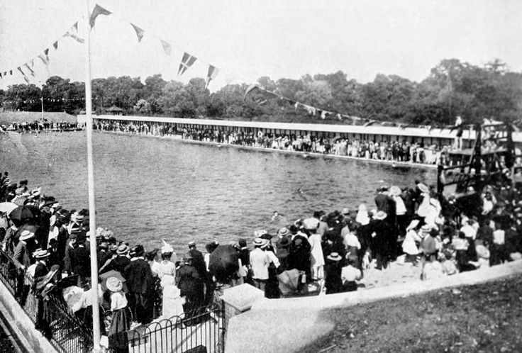 A day out at Tooting, London bathing lake. Plenty of people but not many are in the water. It must have been a cold day in this photograph taken around 1915.