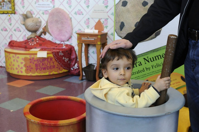 """Davin Chappell, 1, visits the Portland Children's Museum's new exhibit: """"Storyland: A Trip Through Childhood Favorites,"""" featuring interactive, life-size scenes from classic children's books. It runs through May 5."""