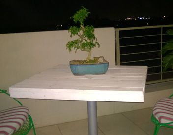 Outside pallet table. White paint with steel base.