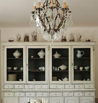 vintage white hutch with dark painted interior - really shows off the white/ish pottery and dishware