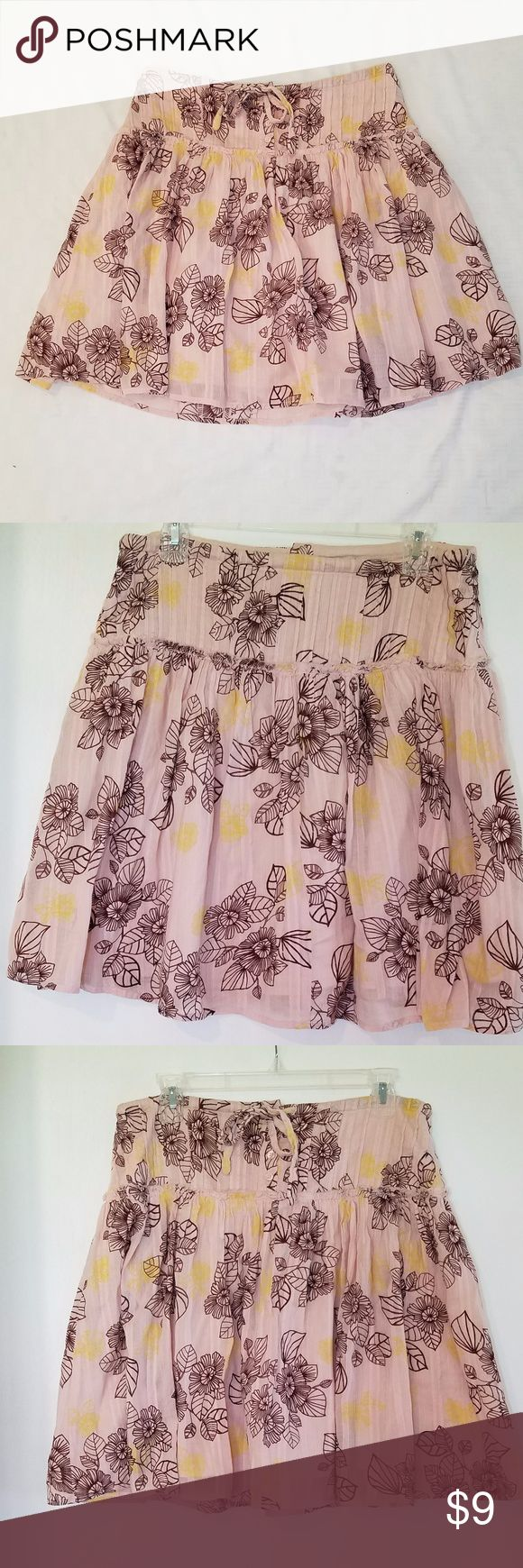 """Lux floral pink skirt flowy lightweight This is a beautiful, lightweight soft pink with brown and yellow florals skirt by LUX with a drawstring waist.  Size 9  Condition: pre-owned but good condition, no stains, tears or snags  Features: drawstring waist button fly under solid light pink lining the seam around the hips has an unfinished look to it machine washable 100% cotton Made in India  Measurements while item is lying flat without stretching: Length from top to bottom: 20.25"""" waist (to…"""