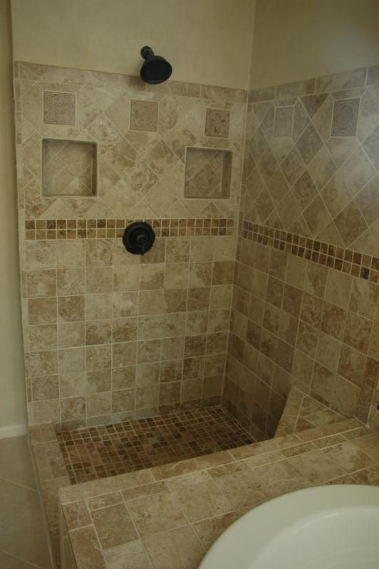 Roswell tiled shower.  Cubbies beside shower stack?  If enough room, might keep the area dryer.
