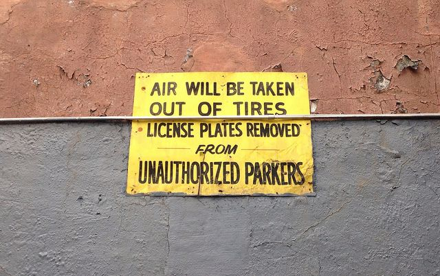 Private No Parking Sign in New York City Warns That Air Will Be Taken Out of Tires & License Plates Removed