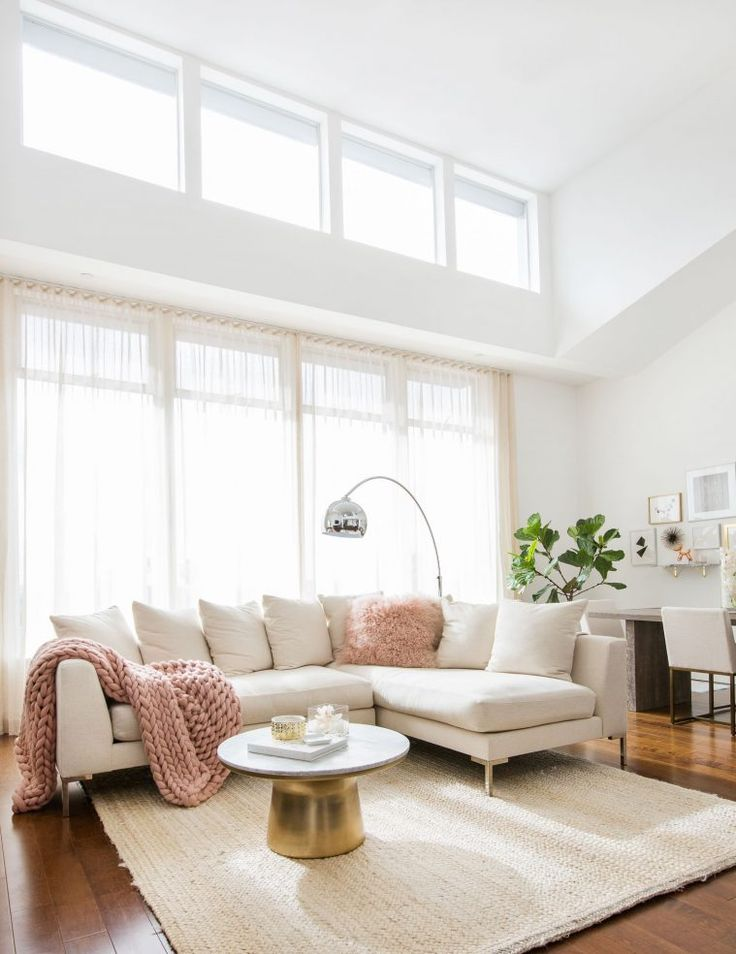 MARIANNA HEWITT HOME TOUR | LIVING ROOM - SECTIONAL COUCH - CHUNKY KNIT BLANKET  - MARBLE TABLE - GALLERY WALL - HIGH CELINGS - NEUTRAL COLORS - BLUSH PINK  - MONGOLIAN FUR PILLOW - FIDDLE FIG TREE