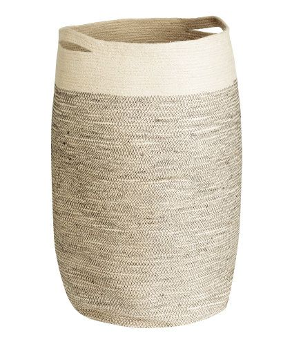 Natural white. Jute laundry basket with two handles. Diameter approx. 13 3/4 in., height 25 1/2 in.