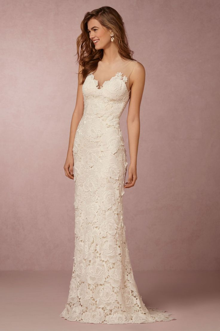 Lace wedding dress with a bold floral motif. The figure hugging silhouette and illusion neckline make this dress anything but old-fashioned | Jolie Gown by Catherine Deane for BHLDN
