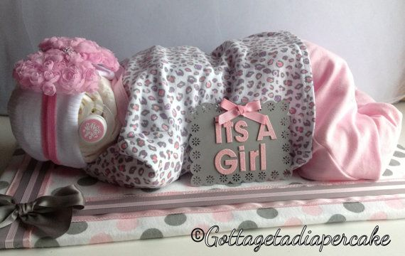 Hey, I found this really awesome Etsy listing at http://www.etsy.com/listing/105114515/sleeping-diaper-babies-diaper-cakes-baby