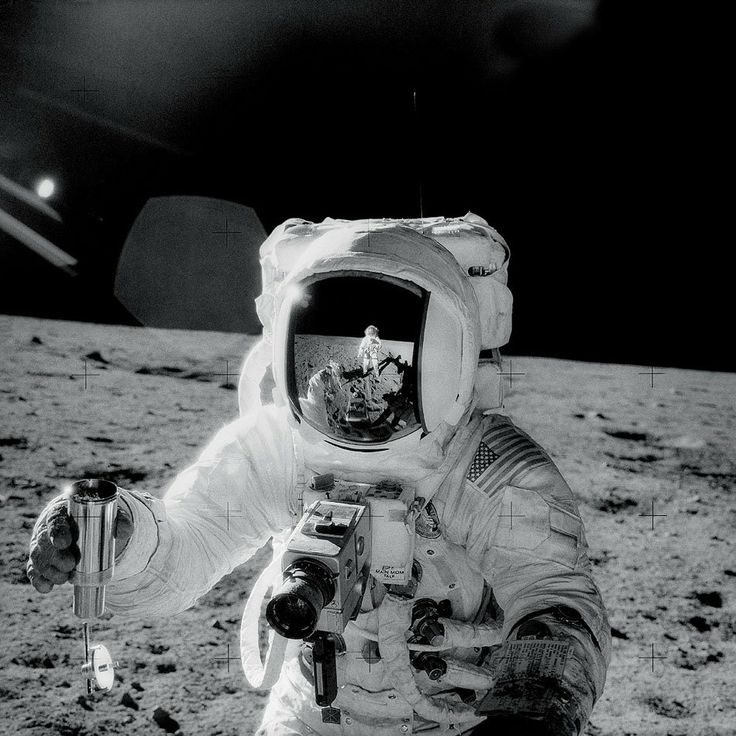 """In November of 1969, Apollo 12 astronaut-photographer Charles """"Pete"""" Conrad recorded this masterpiece while documenting colleague Alan Bean's lunar soil collection activities on the Oceanus Procellarum."""