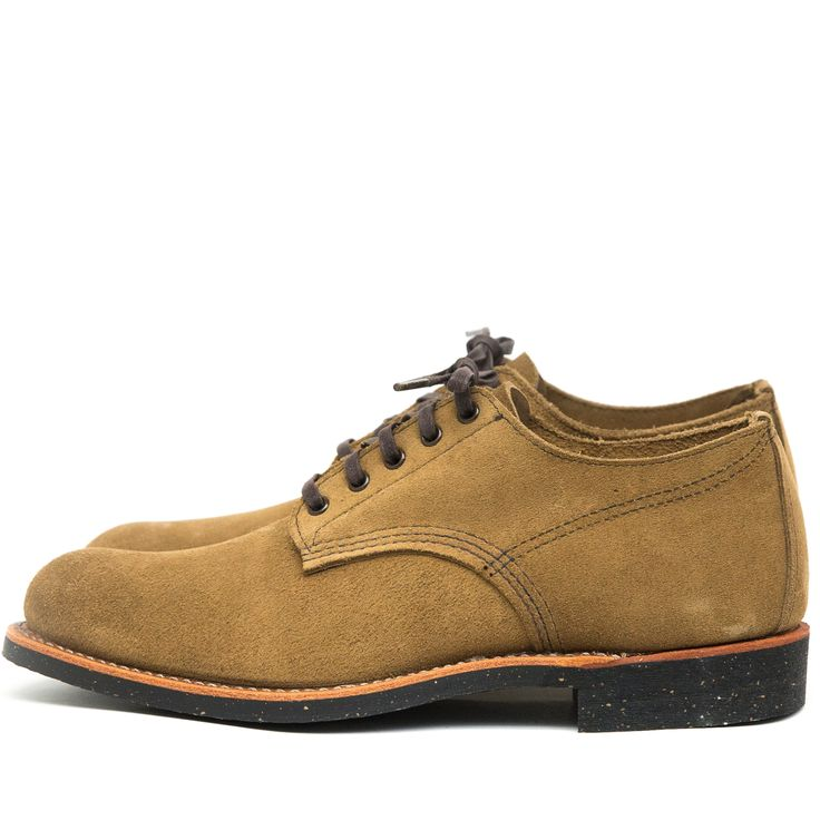 """The Red Wing Shoes Merchant Oxford 8043 Olive Mohave is a classicRed Wing Shoes Oxford work shoe and is made in Red Wing, Minnesota.The Merchant Oxford is based ontraditionalwork boots from the 1920's, whenRed Wing started makingboots withouttoe reinforcementto provide a more comfortable fit without stress points.The Merchant is based on a style whichwas called """"black chief"""" and was made ... Read More"""