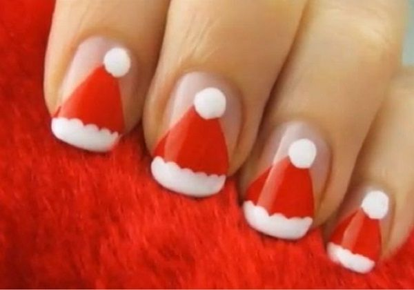 Feel the Christmas air with these cute Santa hat nail arts.
