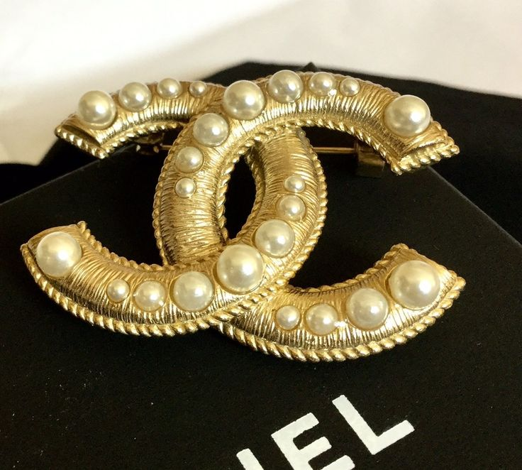 CHANEL     The latest 2016 Artisan Classic Brooch Pin adorned with gradual pearls   The shade of gold is subdue yet very elegant and classy looking  H