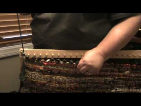 How to remove a finished twined rug from a peg loom.by 25 millbrook...  She does the reverse of iamauntmeem and removes rug from pegs first, then rod.  She discusses running something like blue jean strips down the end loops where the rods were but does not show it.