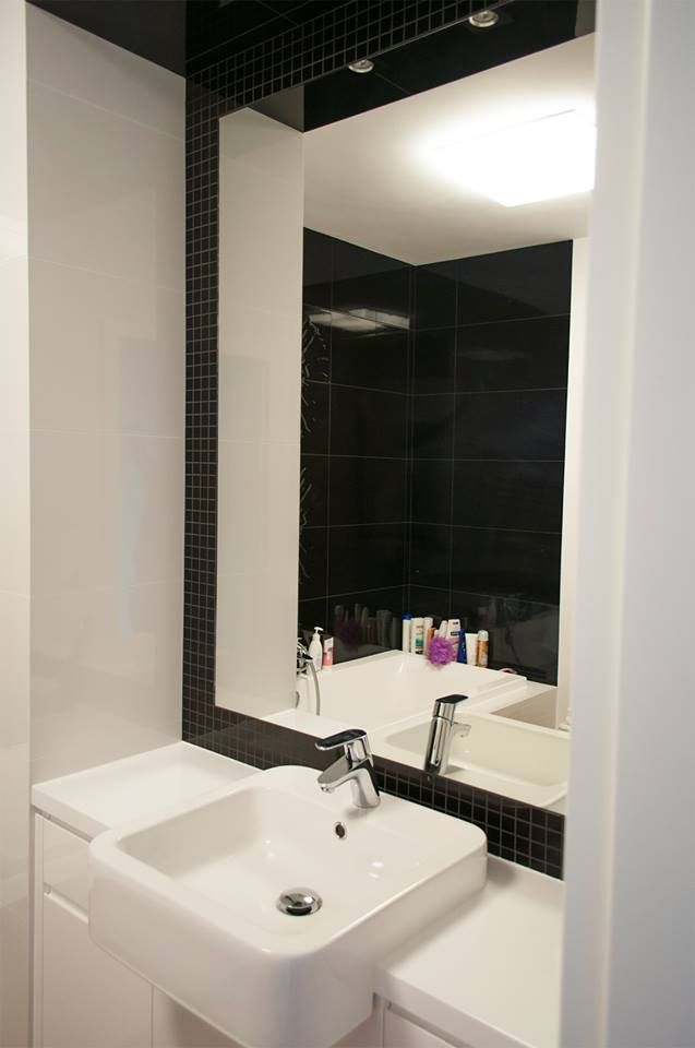 black and white bathroom, half built in washbasin , hatria