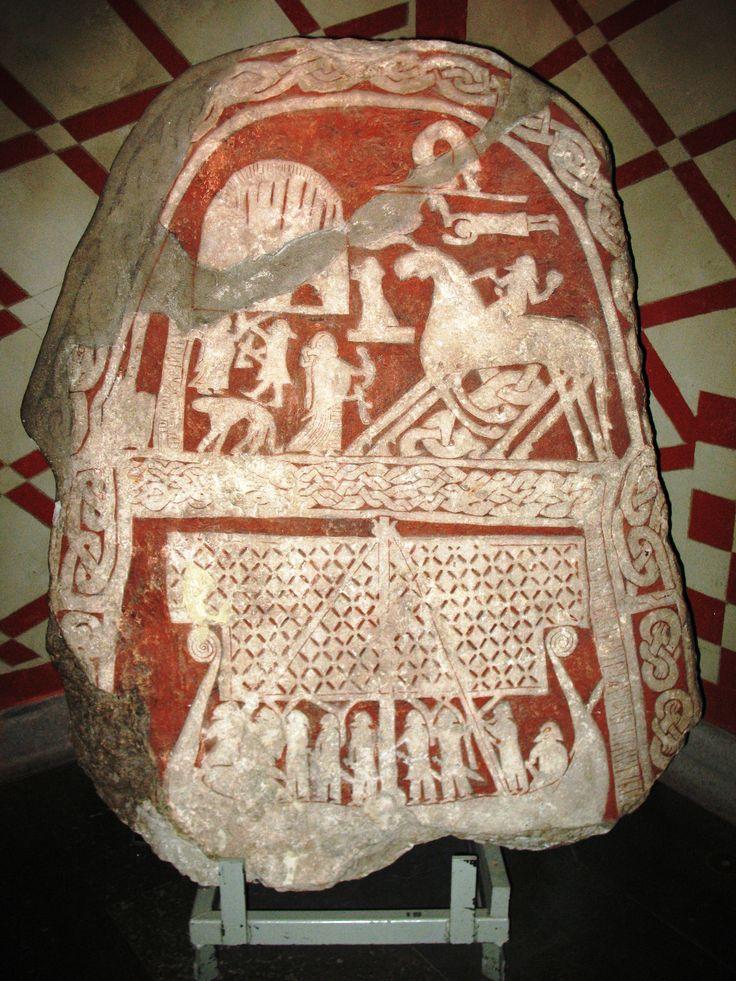 A runestone from Sweden, depicting a longship and Odin riding his eight-legged horse, Sleipnir .