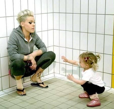 """P!nk giving Willow that :Mommy Look"""" and Willow throwin a karate move on mama... lol, cute pic of my two favorite women"""