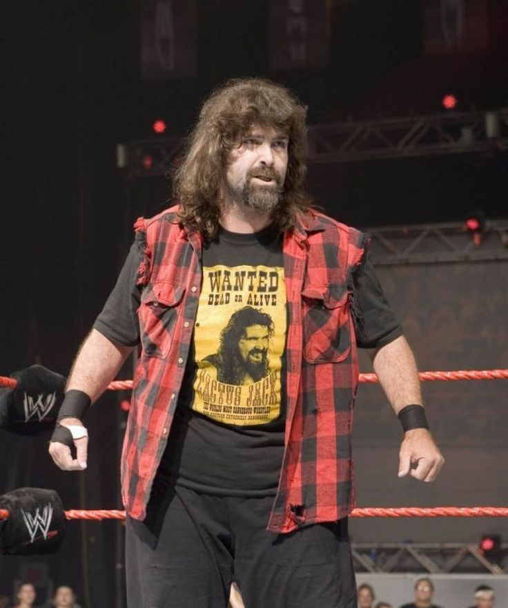 I would wear what Mick Foley wears but minus the pants put boot cut jeans and a nice belt.