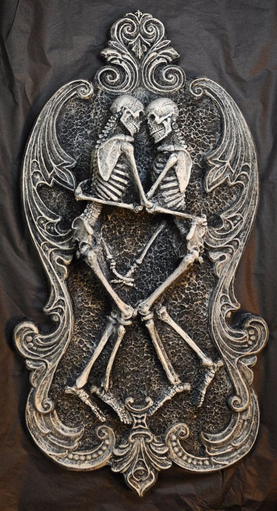 """The skeleton lovers sculpture represents the theme of eternal love. Excavations have revealed skeletal remains in a similar embrace, most famously in the Lovers of Valdaro.  -14"""" x 7.5"""" wall plaque -Cast in high quality resin -Hand painted, hanger on the back. -Available in Pewter OR Brass ..."""