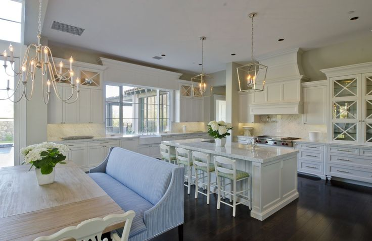 This sleek white kitchen and dining area was completed by Sonora West. #luxeAZ
