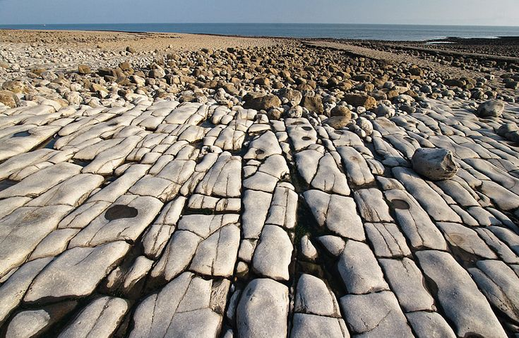 Llantwit Major, Vale of Glamorgan, Bridgend - Llantwit Major Beach is located at the shore of Bristol Channel, west of Cardiff. Due to erosion, rocks on the shore may appear as an artificial cobblestone pavement if seen from certain angles. But in fact it's fully natural.