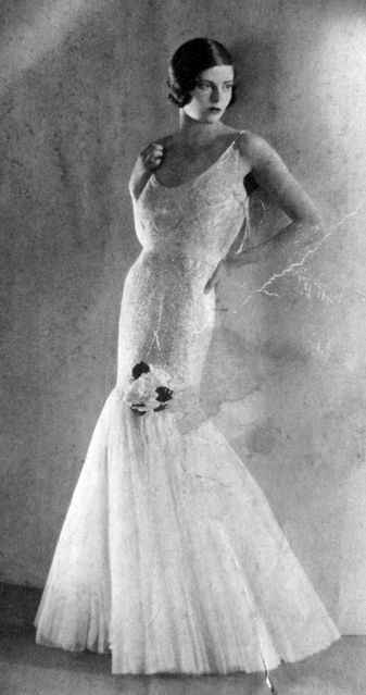 1930's Vogue Paris - Callot Soeurs Tulle Evening Dress - Attuned to the Orientalism of the decade, Callot Soeurs reined the silhouette into a cylindrical wrap, effortless in lingerie-weight fabric.