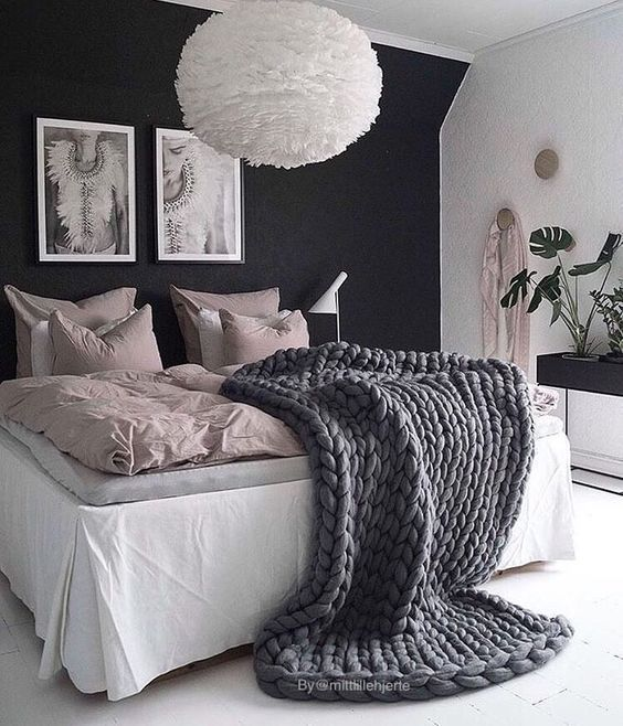 rich wall with white. luscious textiles. live plants.