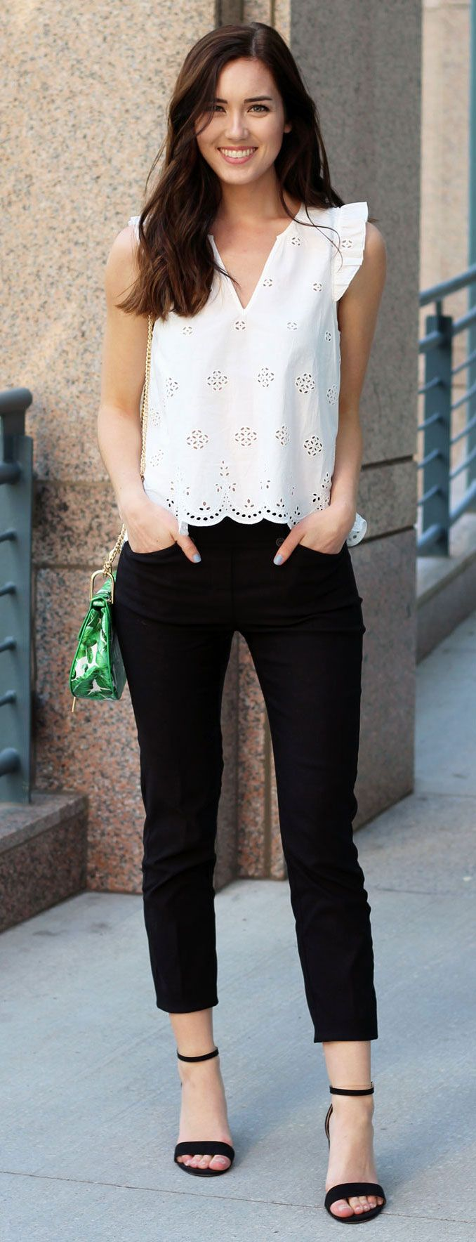 The perfect black and white outfit to still look young and sexy. These black trousers are so flattering, and the eyelet white top is on sale! By fashion blogger Marie's Bazaar