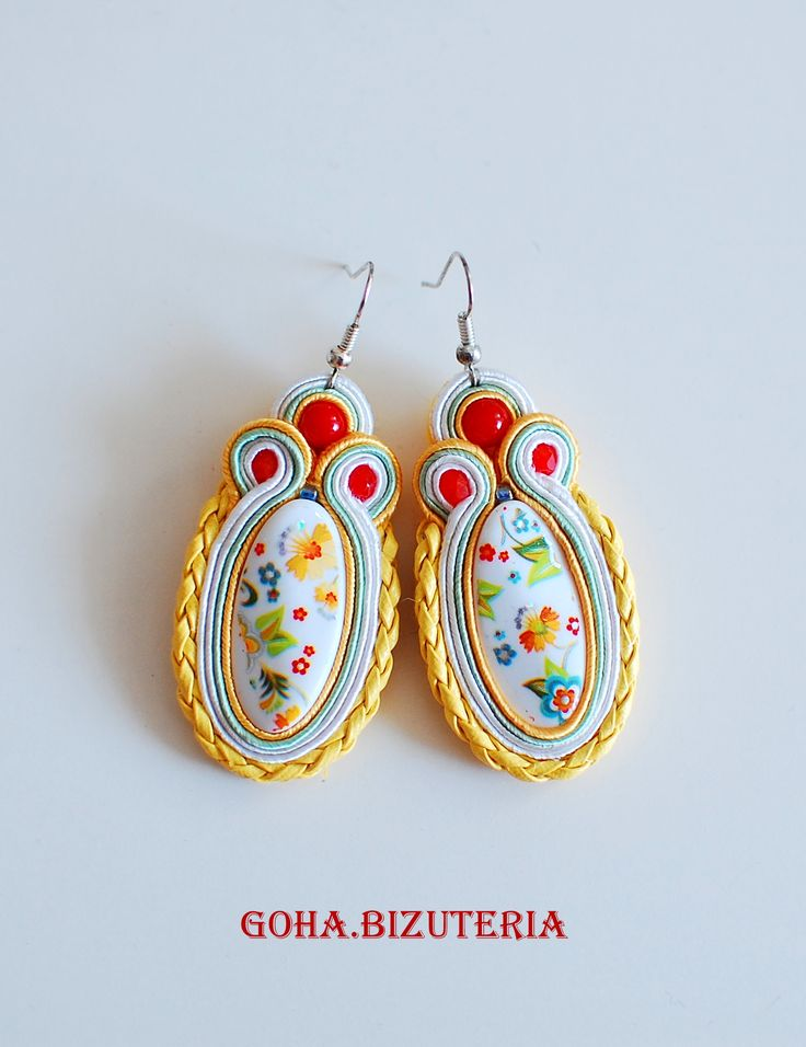 https://www.facebook.com/GOha.Bizuteria/  Earrings in vivid colors. In the center is a white bead decorated with flowers. The whole was finished with yellow strap which gives them character.