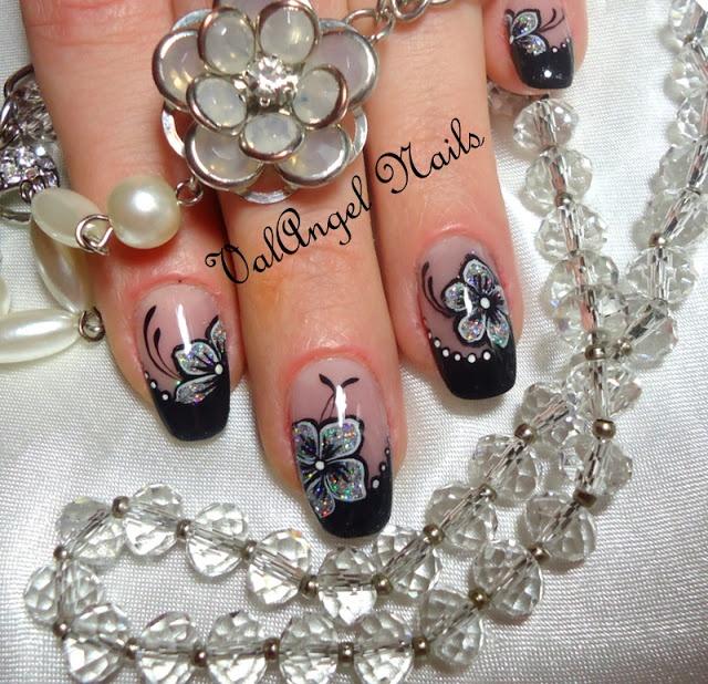 http://valangelnails.blogspot.it/2013/01/nail-art-flowers-of-diamonds.html