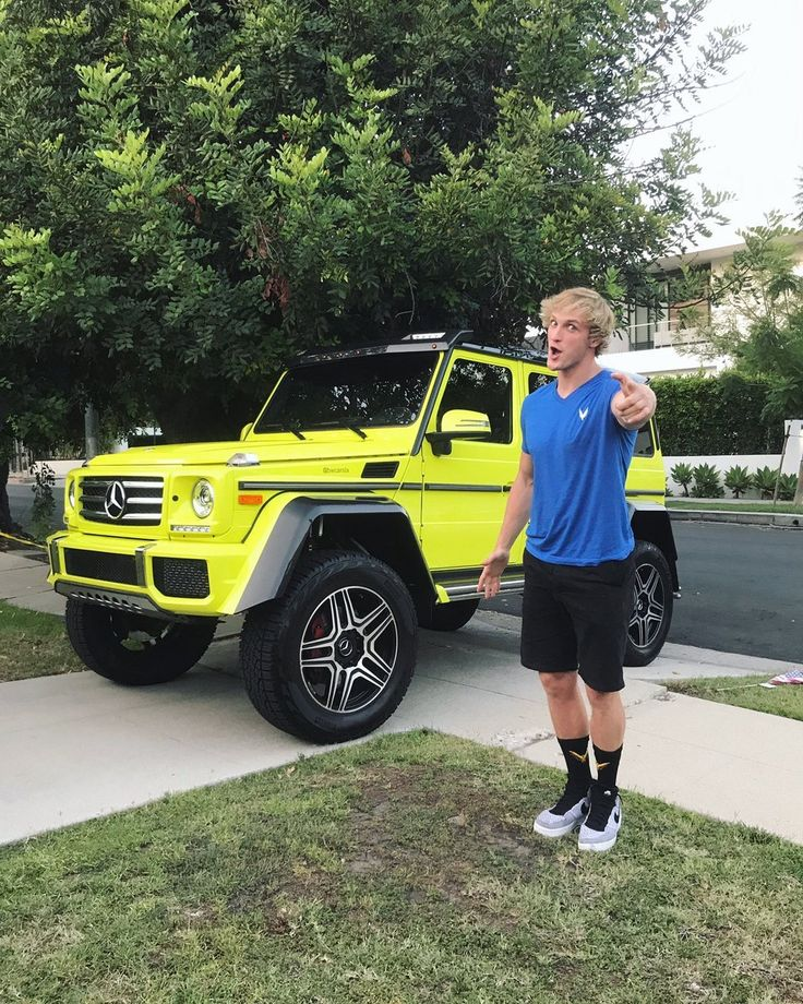 Logan Paul next to his possible new car.