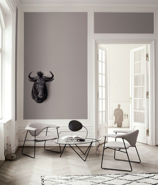Bright white and grey interior with beautiful high ceilings and minimalist decor.