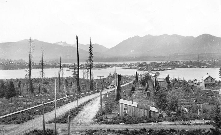 1890: View looking north on Main from 7th Ave - Before False Creek was filled in.