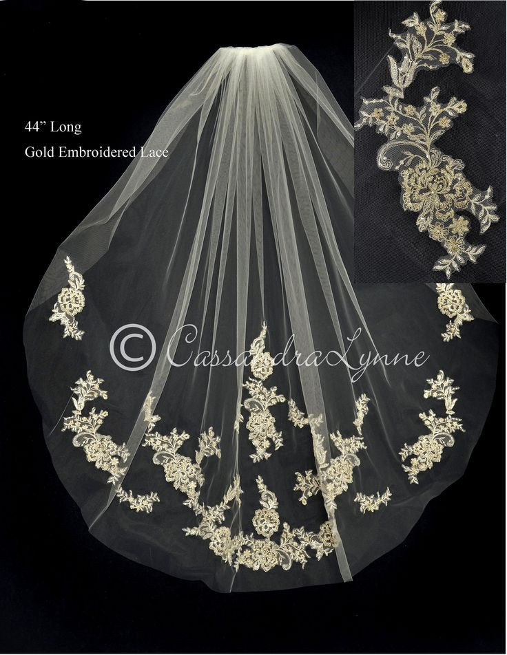 Gold embroidered lace appliques with rhinestones and beads embellish this cut edge wedding veil. It is 44 inches long and 72 inches wide , on a four inch metal comb.