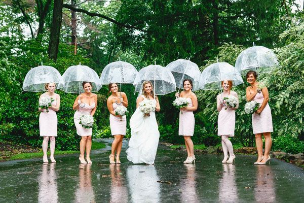 Keep covered in style with clear umbrellas that won't detract from your gorgeous dresses and flowers.