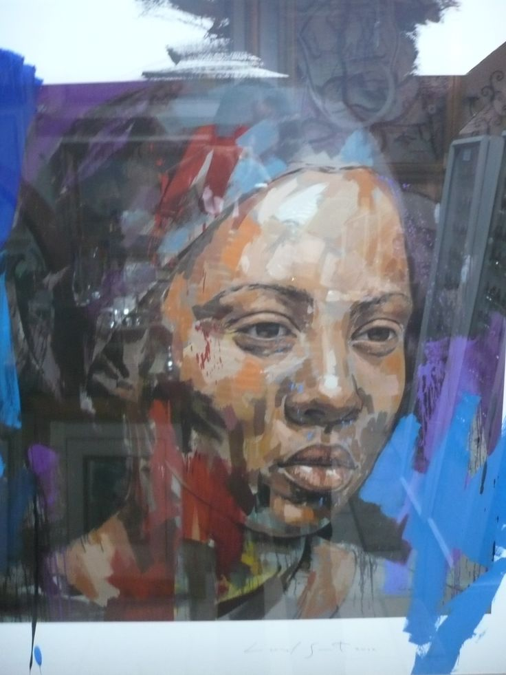 Lionel Smit. its amazing how his express strokes create such a realistic looking final peace as you look at this african woman. see how the skin tome is complimented by the dominant blue backround.