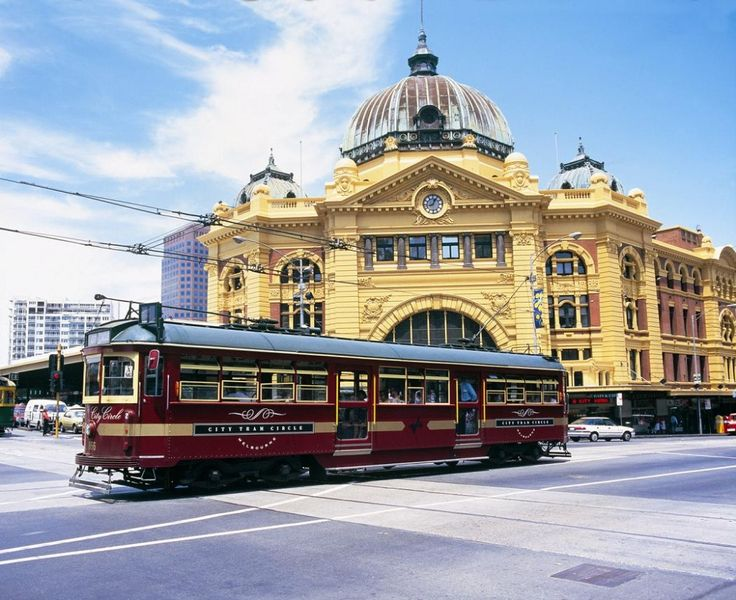 2 Melbourne icons: Flinders St Station and the free tourist tram that circles the city. Melbourne, VIC Australia