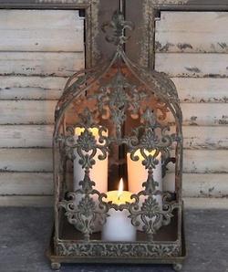 candles in a fleur de lis lantern