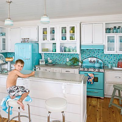 Retro beach kitchen. I am a fool for the turquoise refrigerator, stove and backsplash. For a cute lake house