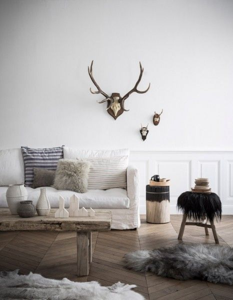 pale wooden floors, off white sofa and washed woods, accents of either dark charcoal or black