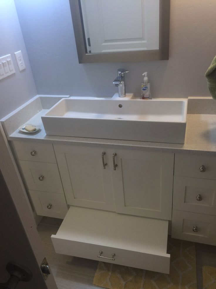 White shaker style cabinets, kids step stool built in, surface mount sink, white quartz counter top